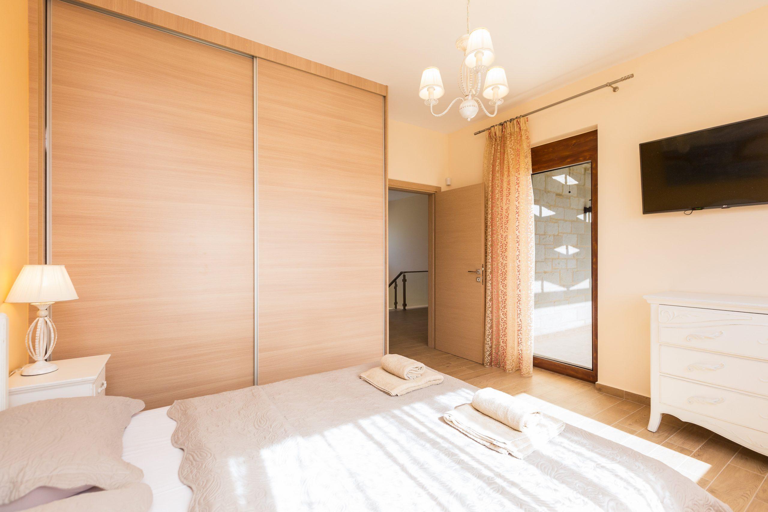 modern greek homes- bedroom interior- Kyriakidis Construction Company